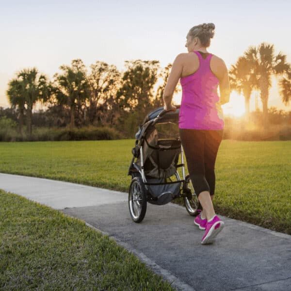 Woman running with stroller